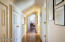 closets line the hallway in the master suite