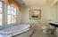 Jack and Jill style bathroom includes 2 separate bathrooms that share a walk in shower.