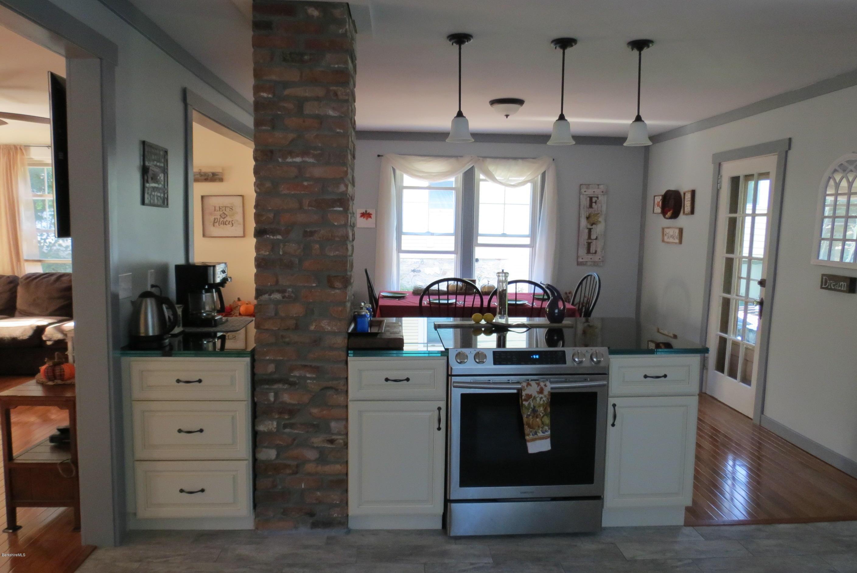 ... Oak Hardwood Floors In Bonus Area, Living Room U0026 Dining Room  Complimented By Ceramic Floors In Kitchen U0026 Baths. Newer Kitchen Cabinets  With Custom Glass ...