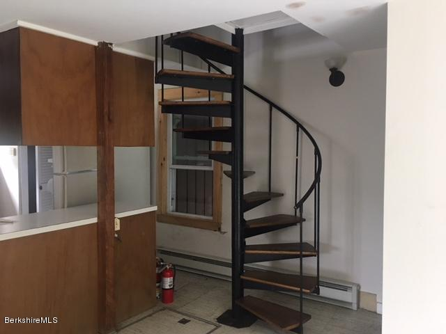 spiral stairs from kitchen to 2nd level