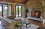 LIVING ROOM STONE FIREPLACE AND MAHOGANY FRENCH DOORS