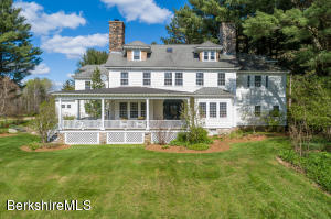 WEST-FACING, THREE STORIES, LARGE COVERED-PORCH, STONE CHIMNEYS AND GARDENS GALORE