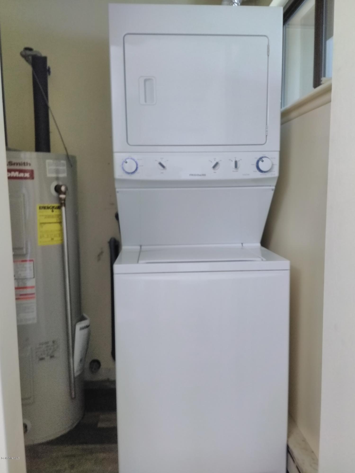 Laundry & hot water tank in 1/2 bath