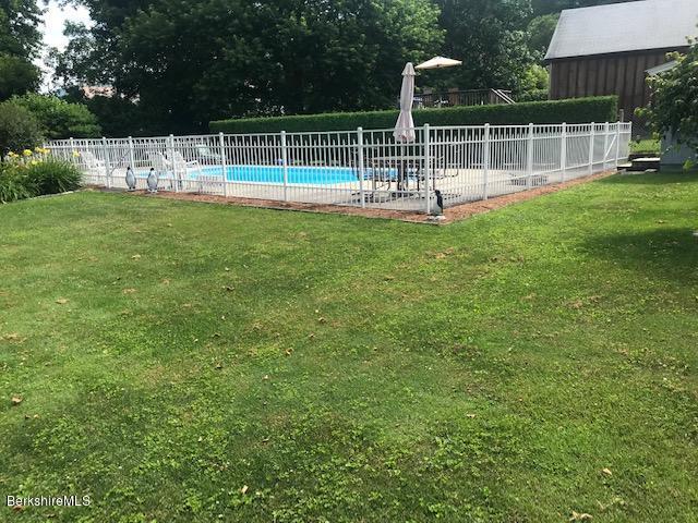 pool  with white aluminum fence