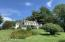 THERE ARE THREE LARGE LAWNS WITH EXTRAORDINARY PERENNIAL GARDENS