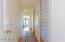 Master bedroom hallway with shoji screen doors on the closets.