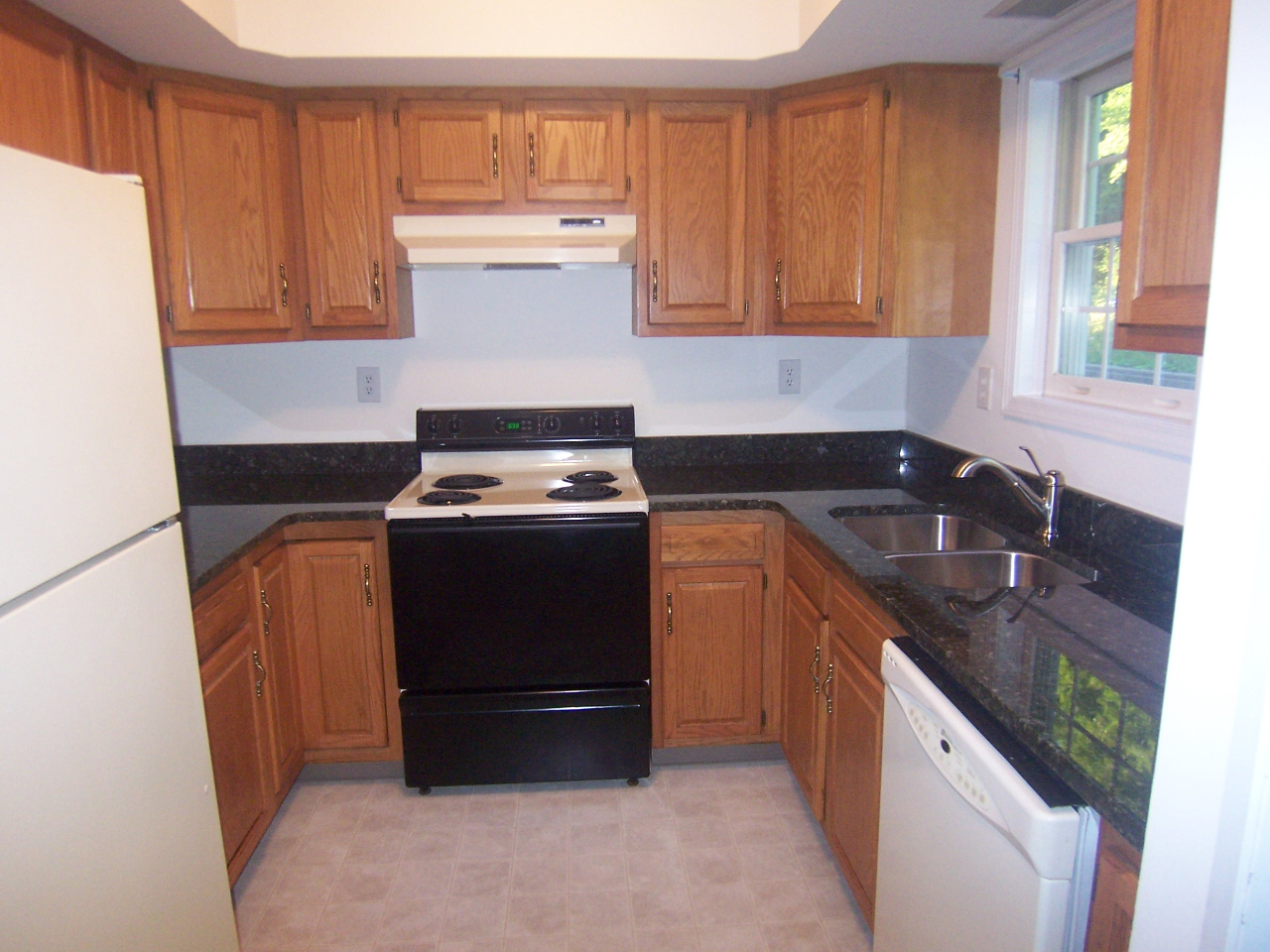 unit one kitchen with granite counters
