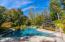 Gunite / pebble tech pool with waterfall