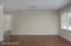 Lower level family room with bonus room beyond.