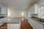 Granite counters and lots of storage in the kitchen.