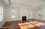 The bright living room has three exposures and a gas fireplace.