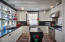 Honed black granite counter tops, custom cabinetry and quality appliances.