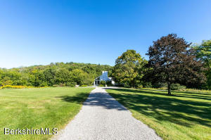 Grand approach to this eloquent estate property.