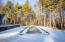 winter view of gunite heated pool and jacuzzi