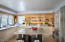 kitchen with granite island, stainless steel counters,