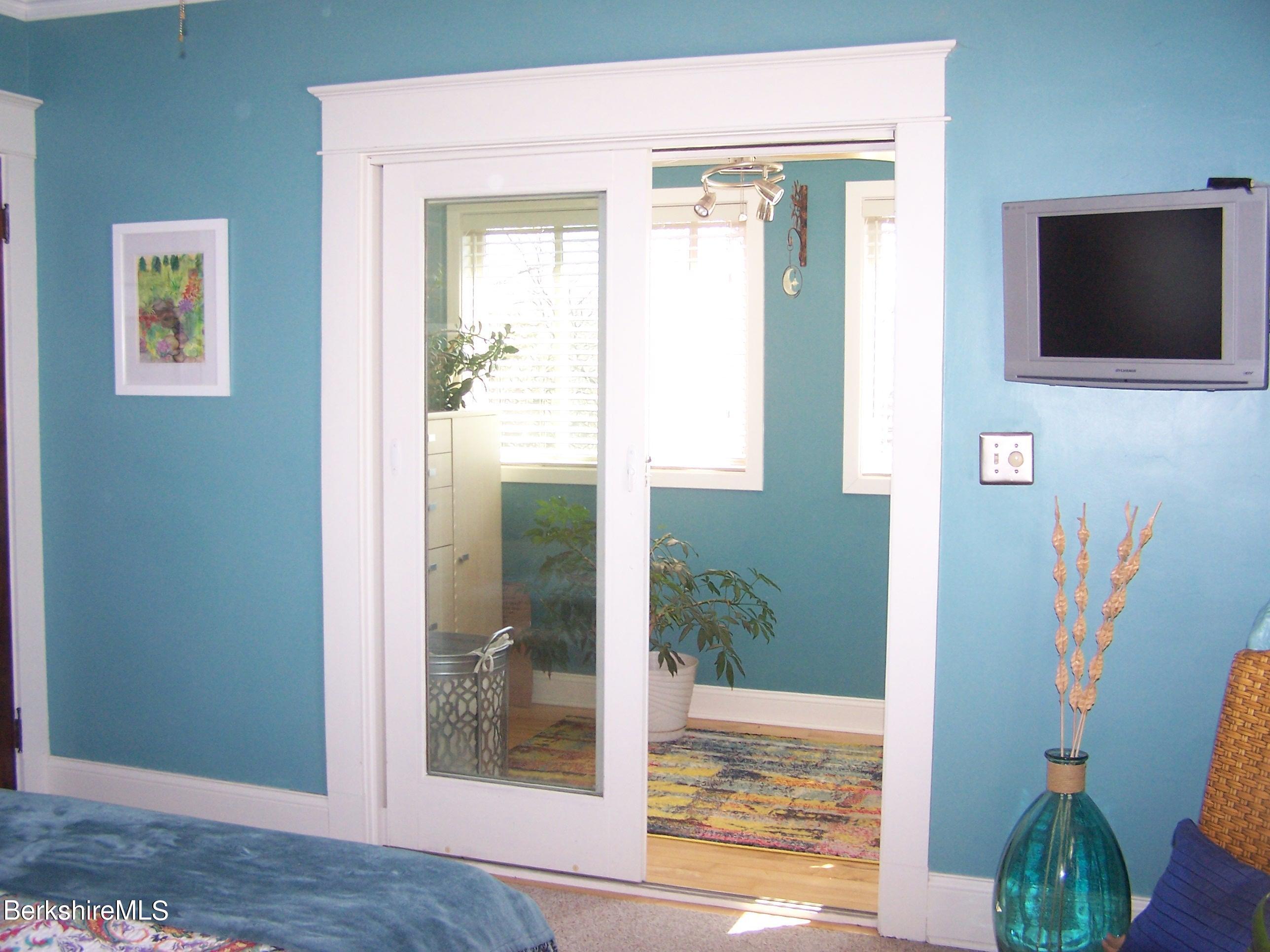 Primary Bedroom to Sunroom
