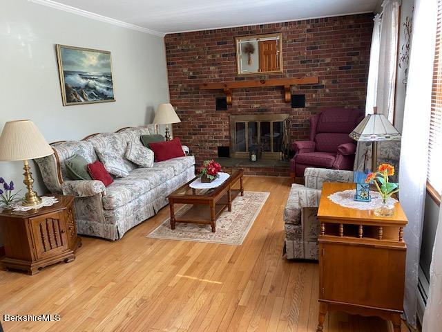 spacious living room , oak floor