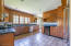 Large kitchen, granite counter tops with a dutch door to the backyard