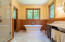 The primary bathroom features marble floors, counters and large shower.