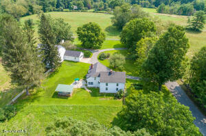 Aerial of the house and barn.