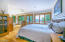 Main Level Primary Bedroom Suite w/ Ensuite Bath, Walk In Closet, Gorgeous Lake Views & Deck Access