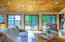 Main Level Great Room/Living Room with Vaulted Ceiling & Wood Burning Fireplace