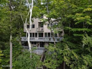 Tucked into the woods with multiple decks and views