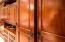 Rich wooden closets and cabinets throughout.