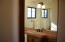 Custom wood cabinets with stone accents
