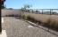 Backyard is Finished and Landscaped and enclosed within Wall and Fence.