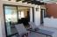 Large Front Terrace shaded by Pergola and with Views to Common Area Pool, Decks, and Gardens.