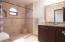 Single Vanity Bath in Separated Guest Suite.