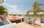 patio off kitchen with outdoor living area, ideal for coffee and sunrises