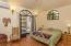 Master bedroom with full bath. Adjacent guest room with 1/2 bath. Guest room has private entry.