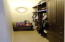 Master walk in closet with custom cabinets
