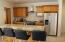Breakfast Bar, Granite Counters, Lots of Cabinets and Stainless Steel Appliances.