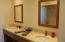 Main Bathroom features Double Sinks and Granite Countertops.