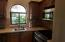 Granite kitchen counters and stainless steel appliances