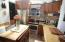 both Kitchens boast New Cabinetry, Granite Countertops and Stainless Steel Appliances