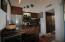 #3303 - Remodeled Kitchen features Granite Countertops, all new Millwork Cabinets. and newer Stainless Steel Appliances.