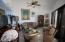 #3303 Livingroom features two sets of glass doors to Oceanview Terrace.