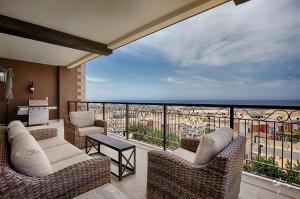 Elevated panoramic golf and ocean views