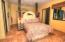 one of two bedrooms downstairs
