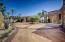 Large Circular driveway fills the back yard