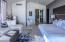 Main Master Suite includes his/hers vanities, spacious walk-in closet, tub, indoor and outdoor showers.