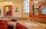 master en-suite bath with his & her's sinks