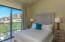 Guest Bedroom #1 features Sliding Glass Doors with views over Green Park.