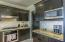 Kitchen features Stainless Steel Appliances and Range Hood.