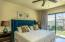 Master Bedroom #1, located on Main Floor, featuring Full Width Sliding Glass Doors to Pool Deck and Yard.