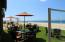 Quivira Beach Club is located right on the Beach and provides outside Tables/Umbrellas with service from the Restaurants/Bars.